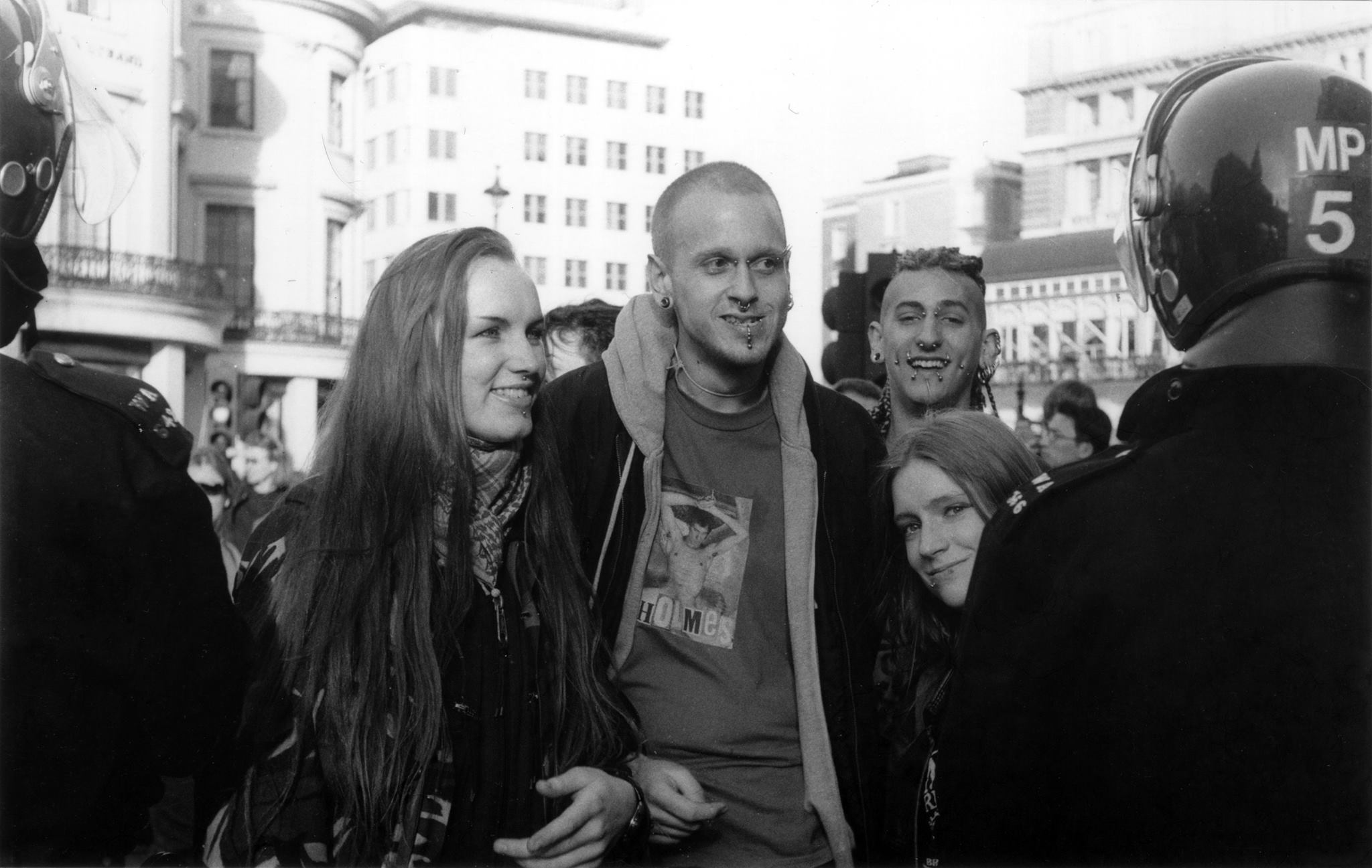With Michael (centre) and friends at an anti-criminal justice bill demo, mid 90s